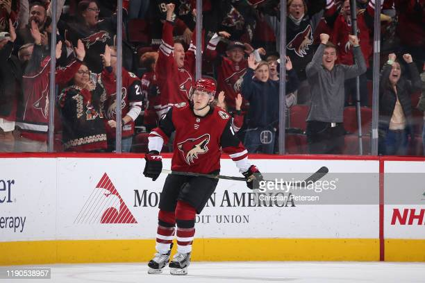 Christian Dvorak of the Arizona Coyotes reacts after scoring the game wining shootout goal against the Anaheim Ducks in the NHL game at Gila River...