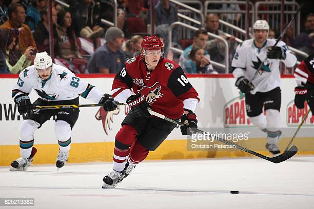 Christian Dvorak of the Arizona Coyotes skates with the puck during the first period of the NHL game against the San Jose Sharks at Gila River Arena...