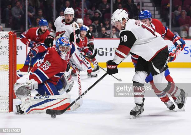 Christian Dvorak of the Arizona Coyotes tries to score on goaltender Charlie Lindgren of the Montreal Canadiens in the NHL game at the Bell Centre on...