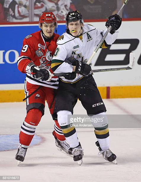 Christian Dvorak of the London Knights battles against Aleksandar Mikulovich of the Niagara IceDogs during Game Four of the OHL Championship final...