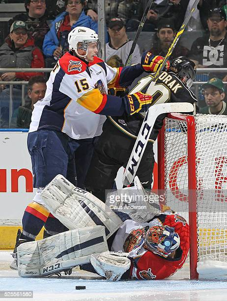 Christian Dvorak of the London Knights draws a penalty for goaltender interference against Devin Williams of the Erie Otters during game four of the...