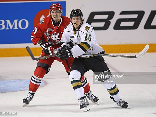 Christian Dvorak of the London Knights looks to tip a shot while being covered by Aleksandar Mikulovich of the Niagara IceDogs during Game Four of...