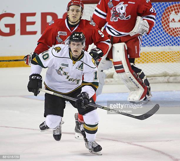 Christian Dvorak of the London Knights skates in front of Jordan Maletta of the Niagara IceDogs during Game Four of the OHL Championship final for...