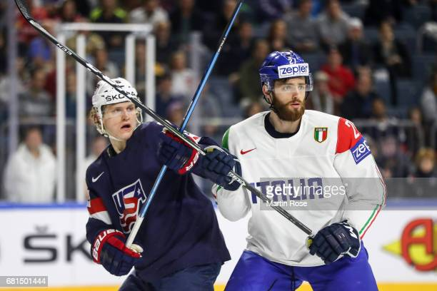 Christian Dvorak of USA challenges Thomas Larkin of Italy react during the 2017 IIHF Ice Hockey World Championship game between USA and Italy at...