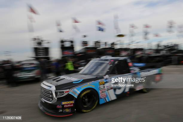 Christian Eckes driver of the Kyle Busch Motorsports SiriusXM Toyota drives through the garage area during practice for the NextEra Energy 250 on...