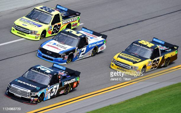 Christian Eckes driver of the SiriusXM Toyota leads a pack of trucks during practice for the NASCAR Gander Outdoor Truck Series NextEra Energy 250 at...
