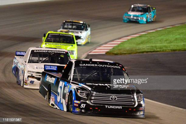 Christian Eckes driver of the SiriusXM Toyota leads a pack of trucks during the NASCAR Gander Outdoors Truck Series CarShield 200 presented by CK at...