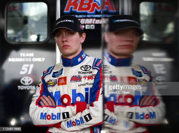 Christian Eckes driver of the SiriusXM Toyota stands in the garage area during practice for the NASCAR Gander Outdoor Truck Series NextEra Energy 250...