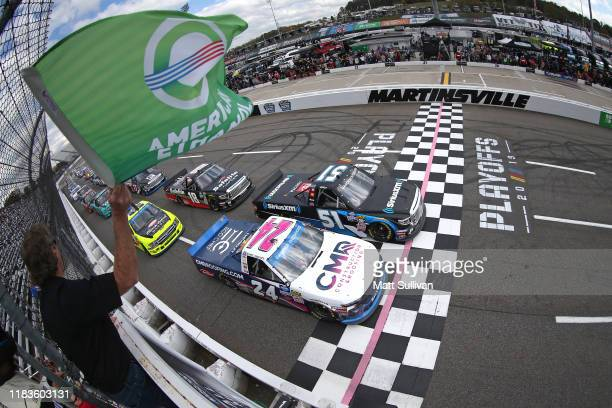 Christian Eckes driver of the SiriusXM Toyota takes the green flag to start the NASCAR Gander Outdoor Truck Series NASCAR Hall of Fame 200 at...