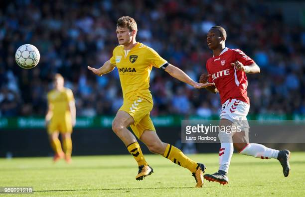 Christian Ege Nielsen of FC Fredericia and DAvila Ba Loua of Vejle Boldklub compete for the ball during the Danish NordicBet Liga match between Vejle...