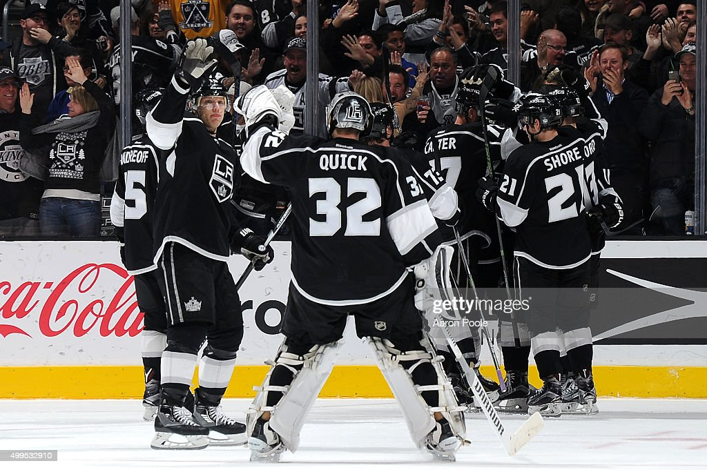 Christian Ehrhoff #10 and Jonathan Quick #32 of the Los Angeles Kings celebrates after a game against Vancouver Canucks at STAPLES Center on December 01, 2015 in Los Angeles, California.