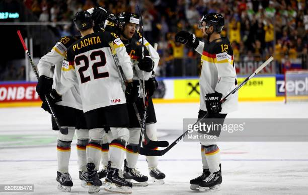 Christian Ehrhoff of Germany celebrate with his team mates after scoring the opening goal ring the 2017 IIHF Ice Hockey World Championship game...