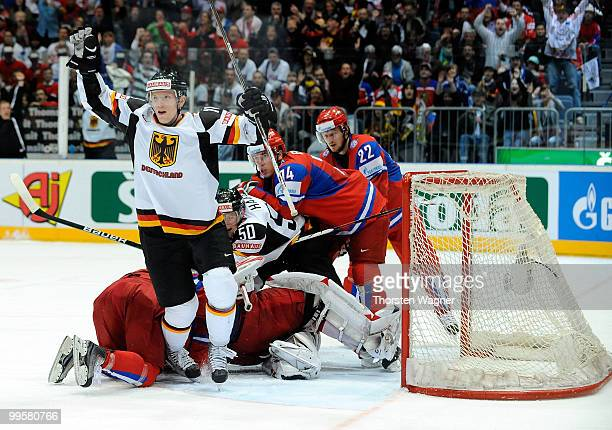 Christian Ehrhoff of Germany celebrates after scoring the first goal for Germany during the IIHF World Championship qualification round match between...