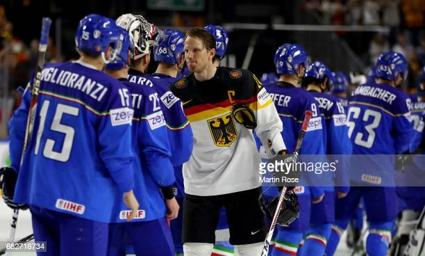 Christian Ehrhoff of Germany celebrates after the 2017 IIHF Ice Hockey World Championship game between Italy and Germany at Lanxess Arena on May 13...