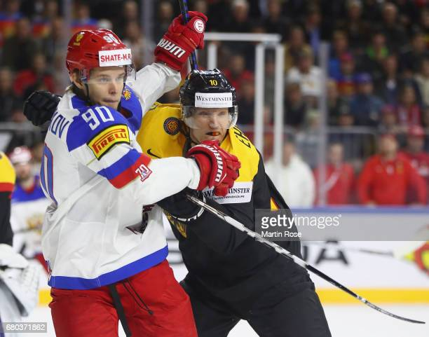 Christian Ehrhoff of Germany challenges Vladislav Namestnikov of Russia during the 2017 IIHF Ice Hockey World Championship game between Germany and...