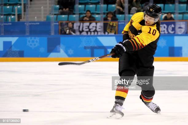 Christian Ehrhoff of Germany shoots in the second period against Norway during the Men's Ice Hockey Preliminary Round Group B game on day nine of the...