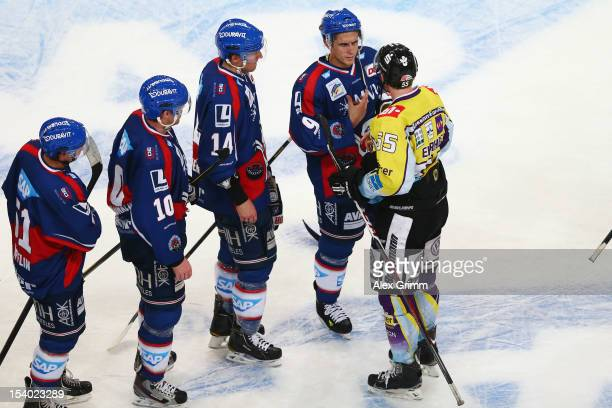 Christian Ehrhoff of Krefeld chats with Marcel Goc of Mannheim after the DEL match between Adler Mannheim and Krefeld Pinguine at SAPArena on October...