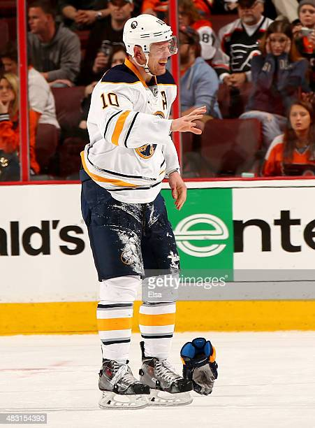 Christian Ehrhoff of the Buffalo Sabres skates off the ice after his ear was cut in the third period against the Philadelphia Flyers at Wells Fargo...