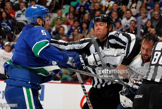 Christian Ehrhoff of the Vancouver Canucks and David Legwand of the Nashville Predators scrap during Game Five of the Western Conference Semifinal of...