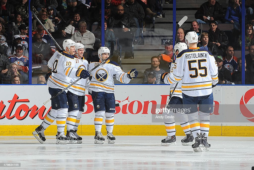 Christian Ehrhoff #10, Torrey Mitchell #17, Cory Conacher #88 and Rasmus Ristolainen #55 of the Buffalo Sabres celebrate after a goal in a game against the Edmonton Oilers on March 20, 2014 at Rexall Place in Edmonton, Alberta, Canada.