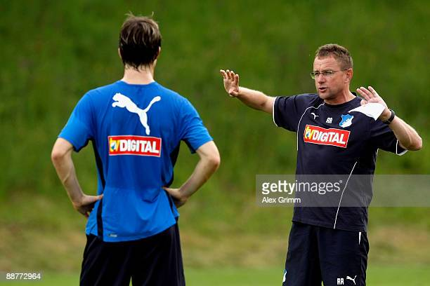 Christian Eichner watches head coach Ralf Rangnick gesture during a training session of 1899 Hoffenheim during a training camp on July 1, 2009 in...