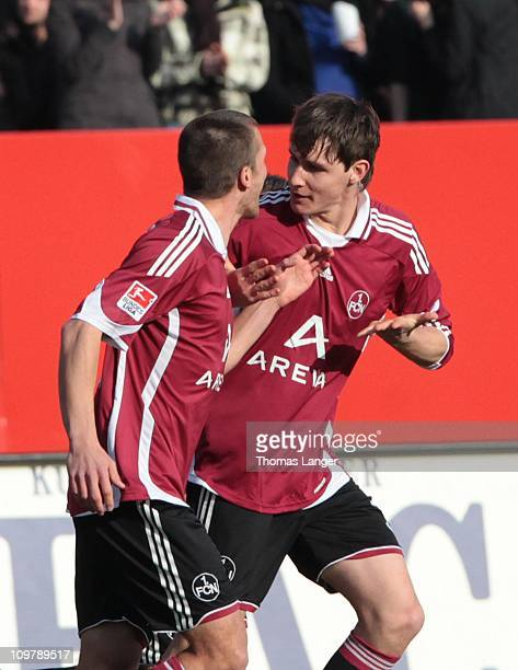 Christian Eigler and scorer Philipp Wollscheid of Nuernberg celebrate Wollscheids 10 goal during the Bundesliga match between 1 FC Nuernberg and FC...