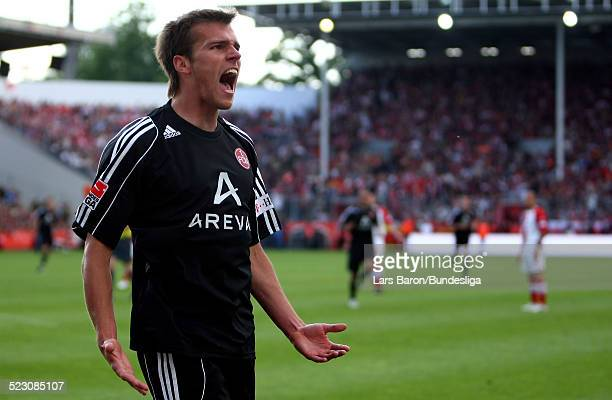 Christian Eigler of Nuernberg celebrates scoring the second goal during the Bundesliga Play Off match between FC Energie Cottbus and 1.FC Nuernberg...