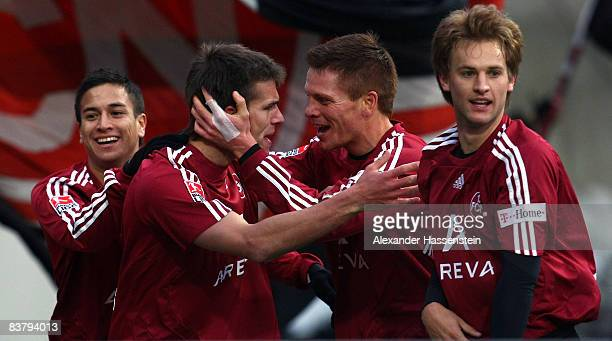 Christian Eigler of Nuernberg celebrates scoring the winning goal with his team mates Peter Perchtold , Pascal Bieler and Chhunly Pagenburg during...