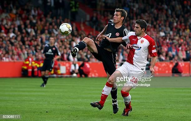 Christian Eigler of Nuernberg scores the second goal past goalkeeper Gerhard Tremmel and Ivan Radeljic of Cottbus during the Bundesliga Play Off...