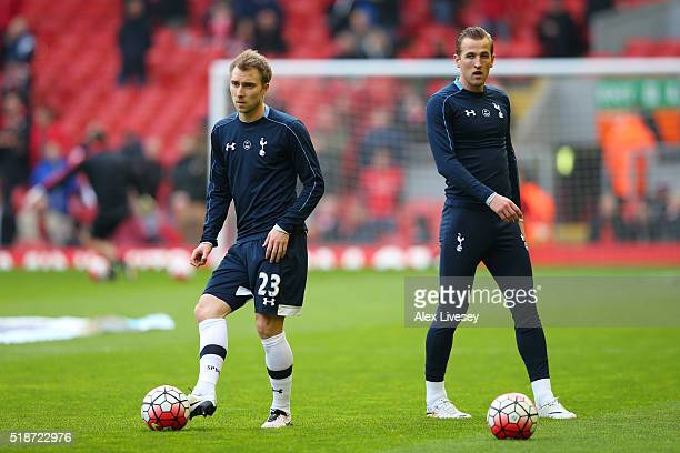 Christian Eriksen and Harry Kane of Tottenham Hotspur warm up prior to the Barclays Premier League match between Liverpool and Tottenham Hotspur at...