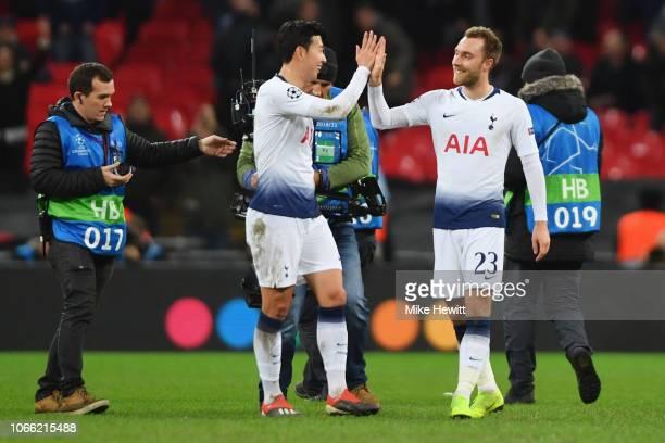 Christian Eriksen and HeungMin Son of Tottenham Hotspur celebrate victory following the UEFA Champions League Group B match between Tottenham Hotspur...