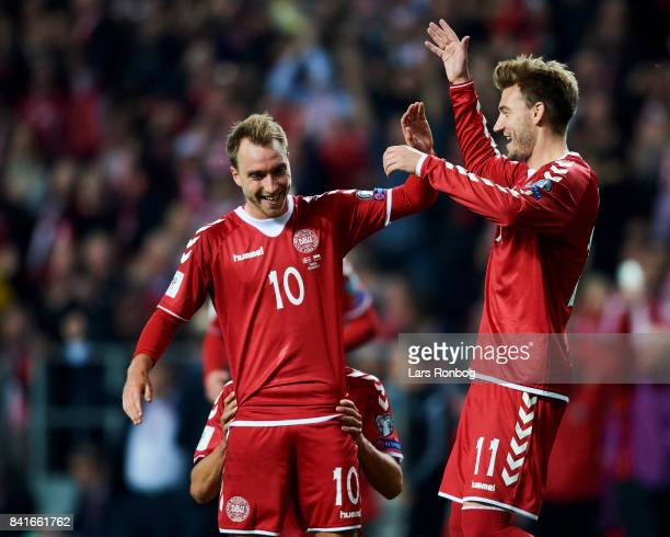 Christian Eriksen and Nicklas Bendtner of Denmark celebrate after the fourth goal during the FIFA World Cup 2018 qualifier match between Denmark and...