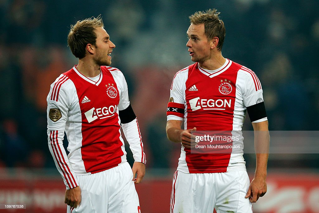 Christian Eriksen (L) and Siem De Jong of Ajax speak after victory in the Eredivisie match between Ajax Amsterdam and Feyenoord Rotterdam at Amsterdam Arena on January 20, 2013 in Amsterdam, Netherlands.