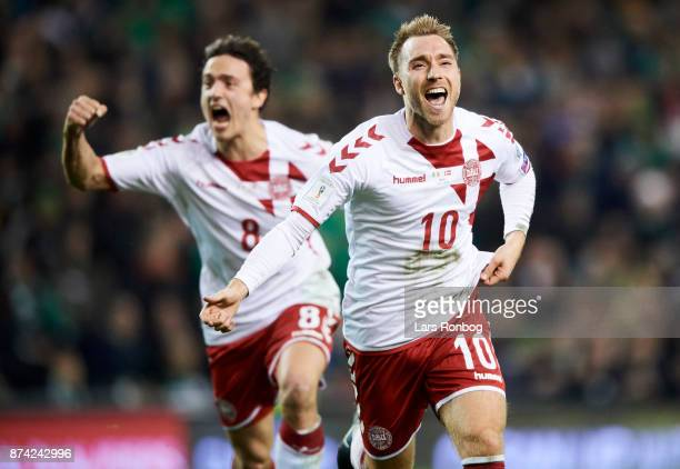 Christian Eriksen and Thomas Delaney of Denmark celebrate after scoring their third goal during the FIFA 2018 World Cup Qualifier PlayOff Second Leg...