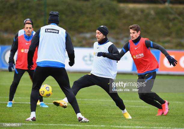 Christian Eriksen competes for the ball with Andrea Pinamonti during an FC Internazionale training session at Appiano Gentile on January 15, 2021 in...