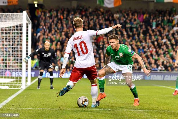 Christian Eriksen crosses the ball during the FIFA World Cup 2018 qualification Play off football match between Republic of Ireland and Denmark at...
