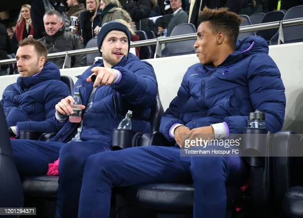 Christian Eriksen Eric Dier and Gedson Fernandes of Tottenham Hotspur are seen on the bench prior to the Premier League match between Tottenham...