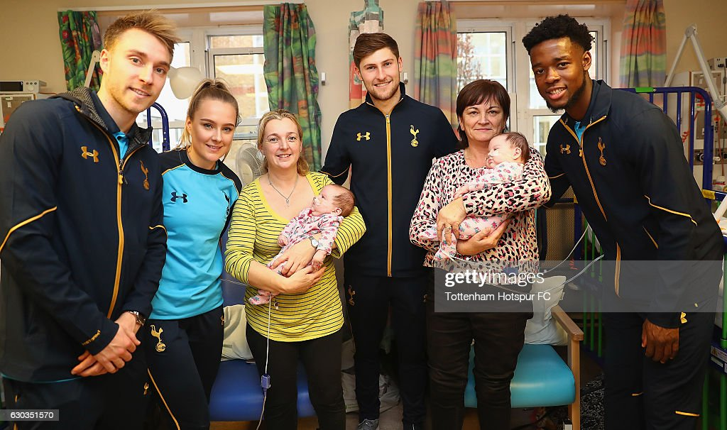 Christian Eriksen, Josie Green, Ben Davies and Josh Onomah of Tottenham Hotspur deliver Christmas presents to Children at Barnet Hospital on December 21, 2016 in London, England.