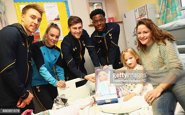 Christian Eriksen Josie Green Ben Davies and Josh Onomah of Tottenham Hotspur deliver Christmas presents to Children at Barnet Hospital on December...