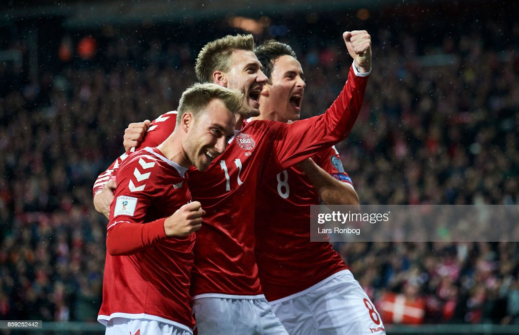 Christian Eriksen, Nicklas Bendtner and Thomas Delaney of Denmark celebrate after scoring their first goal during the FIFA World Cup 2018 qualifier match between Denmark and Romania at Telia Parken Stadium on October 8, 2017 in Copenhagen, Denmark.