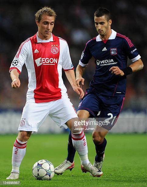 Christian Eriksen of Ajax duels for the ball with Maxime Gonalons of Olympique Lyonnais during the UEFA Champions League group D match between AFC...
