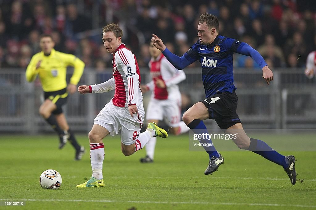 Christian Eriksen of Ajax, Phil Jones of Manchester United during the UEFA Europa League round of 32 match between AFC Ajax and Manchester United FC at the Amsterdam Arena on February 16, 2012 in Amsterdam, Netherlands.