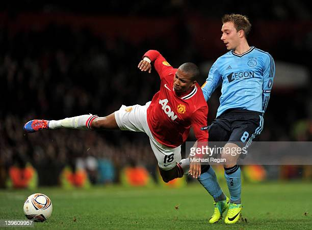 Christian Eriksen of Ajax tangles with Ashley Young of Manchester United during the UEFA Europa League Round of 32 second leg match between...