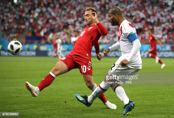 Christian Eriksen of Denmark and Alberto Rodriguez of Peru battle for the ball during the 2018 FIFA World Cup Russia group C match between Peru and...