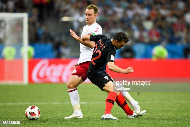 Christian Eriksen of Denmark and Josip Pivaric of Croatia during the 2018 FIFA World Cup Round of 16 match between Croatia and Denmark at Nizhny...