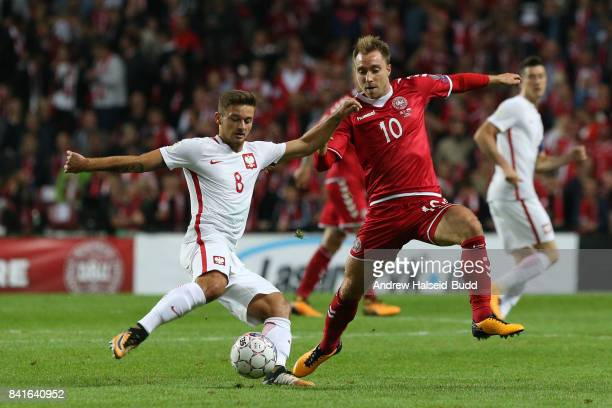 Christian Eriksen of Denmark and Karol Linetty of Poland in action during the FIFA 2018 World Cup Qualifier between Denmark and Poland at Parken...