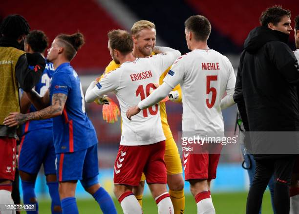 Christian Eriksen of Denmark and Kasper Schmeichel of Denmark and Joakim Maehle of Denmark interact after the UEFA Nations League group stage match...