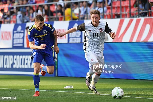 Christian Eriksen of Denmark and Ognjen Vranjes of Bosnia and Herzegovina compete for the ball during the international friendly match between Bosnia...