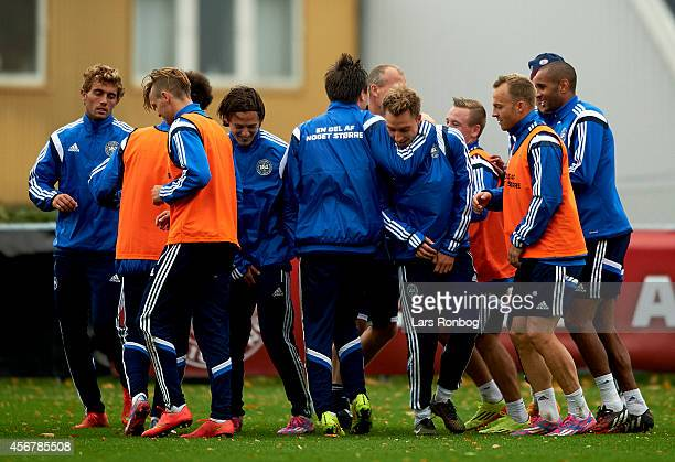 Christian Eriksen of Denmark and team mates training in a bunch during the Denmark training session and press conference ahead of their UEFA EURO...