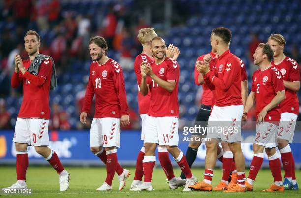 Christian Eriksen of Denmark and teammates celebrate with the fans after the international friendly match between Denmark and Mexico ahead of the...